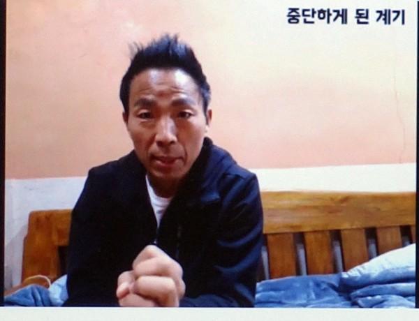 영상을 통해 펜벤다졸 부작용을 증언하는 개그맨 김철민 씨(사진 국회 전문기자협의회 제공)
